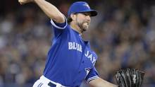 Toronto Blue Jays starting pitcher R.A. Dickey pitches to the Boston Red Sox during first inning AL baseball action in Toronto on Sunday, April 27, 2014. (Frank Gunn/THE CANADIAN PRESS)