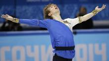 Kevin Reynolds of Canada competes in the men's team free skate figure skating competition at the Iceberg Skating Palace during the 2014 Winter Olympics, Sunday, Feb. 9 in Sochi, Russia. (Bernat Armangue/Associated Press)