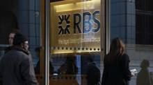 People walk past a Royal Bank of Scotland (RBS) building in the City of London in this Jan. 12, 2012 file photo. (STEFAN WERMUTH/REUTERS)