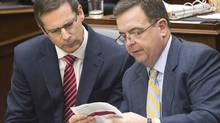 Ontario Premier Dalton McGuinty, left, and Ontario Finance Minister Dwight Duncan, right, study a document before the 2012 provincial budget vote at Queen's Park in Toronto on Tuesday, April 24. (Nathan Denette/NATHAN DENETTE/THE CANADIAN PRESS)