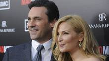"Cast member Jon Hamm (L) and actress Jennifer Westfeldt attend a premiere screening of season five of the AMC series ""Mad Men"" in Los Angeles March 14, 2012. (PHIL McCARTEN/REUTERS/PHIL McCARTEN/REUTERS)"
