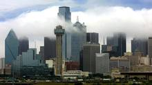 The Dallas skyline is shrouded in clouds (LAWRENCE JENKINS)