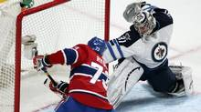Winnipeg Jets goalie Ondrej Pavelec (31) is scored on by Montreal Canadiens Michael Ryder (73) during first period NHL action in Montreal, April 4, 2013. (CHRISTINNE MUSCHI/REUTERS)