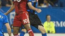 Montreal Impact's Wandrille Lefèvre, right, and Toronto FC's Robert Earnshaw go up for the ball during second half second leg semifinal Amway Canadian Championship soccer action in Montreal, Wednesday, May 1, 2013. (Graham Hughes/THE CANADIAN PRESS)