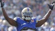 "Winnipeg Blue Bombers' Odell Willis (40) the unofficial mayor of ""Swaggerville"" celebrates a sack on Saskatchewan Roughriders' Darian Durant (4) during the first half of their CFL game in Winnipeg Sunday, September 11, 2011. THE CANADIAN PRESS/John Woods (John Woods/CP)"