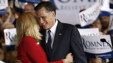 U.S Republican presidential candidate Mitt Romney hugs wife Ann during his Illinois primary night rally in Schaumburg, Illinois, March 20, 2012. (JIM YOUNG/Reuters)