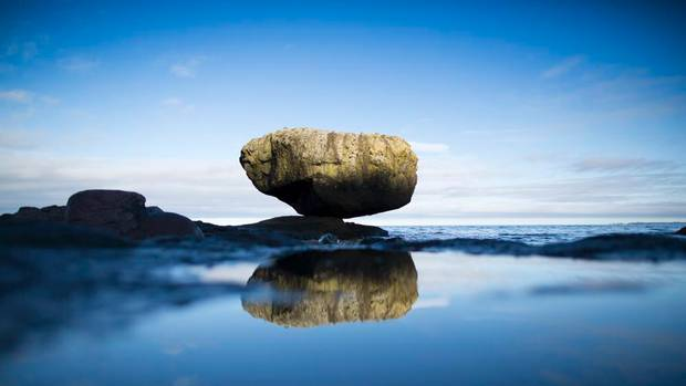 Balance Rock, one of Haida Gwaii's spiritual wonders left behind from the ice age, near the shores of Skidegate on Oct. 3, 2012. (John Lehmann/The Globe and Mail)