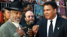Boxers Joe Frazier (L) and Muhammad Ali pose together as they arrive at the 10th annual ESPY Awards which honor excellence in all sports in Hollywood in this July 10, 2002 file photo. Former heavyweight champion Frazier, who earned boxing immortality after his three epic fights with Ali, died on November 7, 2011 at age 67, U.S. media reported. (FRED PROUSER/REUTERS)