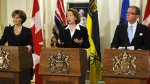 British Columbia Premier Christy Clark (L), Alberta Premier Alison Redford (C) and Saskatchewan Premier Brad Wall (R) address the media after a meeting in Edmonton on Dec. 13, 2011. (DAN RIEDLHUBER/DAN RIEDLHUBER/REUTERS)