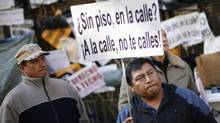 Last week's suicide of a 53-year-old woman who was about to be evicted has inflamed a public already angered by what they see as a lack of compassion among Spanish banks. The placard reads 'Without flat, on the street? Take the street, do not be silent.' (JUAN MEDINA/REUTERS)