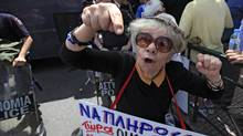 A pensioner takes part in a protest rally during a 24-hour strike against a new austerity package in Athens June 9, 2011 (PASCAL ROSSIGNOL)