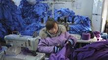 An employee works at a garment factory in Wuhu, Anhui province. (JIANAN YU/JIANAN YU.REUTERS)