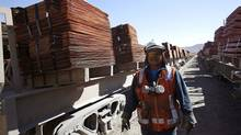 Copper cathodes are loaded for shipping at the Chuquicamata mine and foundry in northern Chile. (IVAN ALVARADO/REUTERS)