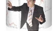 Man surrounded by virtual screen with stock market quotations.