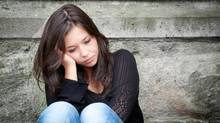 A teen distraught over a conflict with a friend. (Thinkstock)