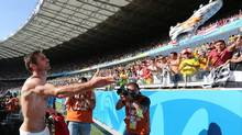 England's Frank Lampard throws a boot to England fans after the group D World Cup soccer match between Costa Rica and England at the Mineirao Stadium in Belo Horizonte, Brazil, Tuesday, June 24, 2014. (Jon Super/AP)