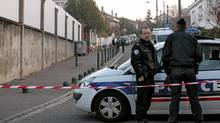 French police stand guard as they provide security outside the Ozar Hatorah Jewish school a day after the shooting in Toulouse, southwestern France, March 20, 2012. (Pascal Parrot/Reuters/Pascal Parrot/Reuters)