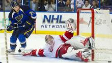 Detroit Red Wings goalie Jimmy Howard makes a save as St. Louis Blues centre T.J. Oshie looks for the rebound during the second period at the Scottrade Center on Tuesday night. (Scott Rovak-US PRESSWIRE/2011 Scott Rovak)