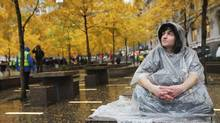 Protester Jorden Eck sits in Zuccotti Park a day after it was cleared of Occupy Wall Street protesters in an early morning police raid on November 16, 2011 in New York city. (Mario Tama/Mario Tama/Getty Images)