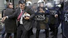 The diffusion of power can mean more protest – and political stagnation. One case in point: The ongoing instability in European countries such as Greece. (JOHN KOLESIDIS/REUTERS)