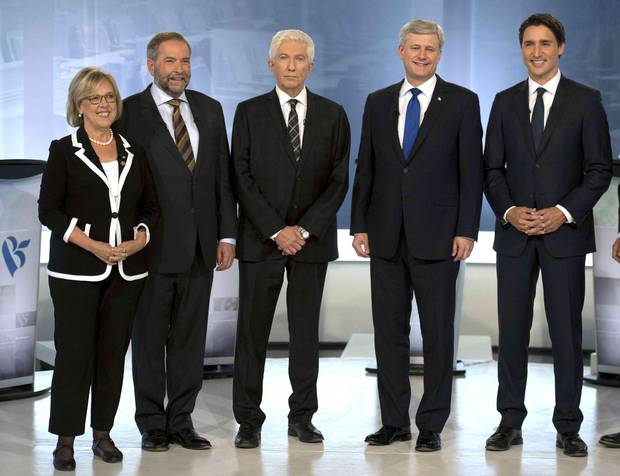 Green party Leader Elizabeth May, NDP Leader Tom Mulcair, Bloc Quebecois Leader Gilles Duceppe, Conservative Leader Stephen Harper, and Liberal Leader Justin Trudeau pose for photos before the French-language leaders' debate in Montreal September 24, 2015.