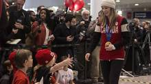 Canadian gold medalist in slope skiing Dara Howell greets waiting family members as she arrives back at Toronto's Pearson Airport from the Sochi Winter Olympics on Monday, February 24, 2014. (Chris Young/THE CANADIAN PRESS)