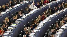 Members of the European Parliament take part in a voting session at the in Strasbourg, France, on Oct. 25, 2011. (VINCENT KESSLER/VINCENT KESSLER/REUTERS)