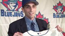 J.P. Ricciardi holds a jersey after he was introduced as the new general manager in 2001. (PETER JONES)