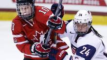 Canada's Gillian Apps (10) and United States' Josephine Pucci (24) battle for position during the third period of a Four Nations Cup women's hockey game on Wednesday, Nov. 6, 2013, in Lake Placid, N.Y. (Mike Groll/AP)