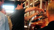 A student closes the still at Moonshine University in Kentucky. (Jimmy Gassler/Moonshine University)