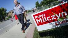 Liberal candidate Peter Milczyn knocks on doors with campaign workers in Etobicoke, Ontario Thursday, July 25, 2013. (Kevin Van Paassen/The Globe and Mail)