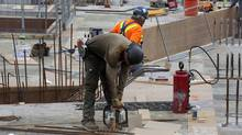 Work being done on a condominium construction site at Bathurst Street and Fork York Blvd. in Toronto on May 29, 2012. Six chief economists say they expect tepid growth in the first half of 2013 but gains later in the year. Canada's housing market is expected to cool. (Deborah Baic/Deborah Baic/The Globe and Mail)