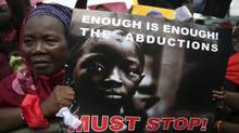 A woman holds a sign during a protest in Lagos on May 5, 2014, demanding the release of abducted secondary school girls from the remote village of Chibok. The abductions were carried out by the Islamist rebel group Boko Haram. (AKINTUNDE AKINLEYE/REUTERS)