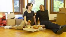 Couple eating pizza in new apartment (Hemera Technologies/(c) Hemera Technologies)