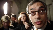 Industry Minister Tony Clement speaks to reports in Ottawa on Wednesday after the Throne Speech. (BLAIR GABLE)