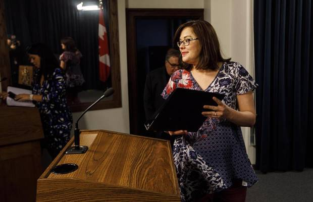 Alberta Justice Minister Kathleen Ganley makes her way to the podium to provide details of the proposed cannabis legislation in Edmonton Alta, on Thursday Nov. 16, 2017.