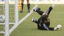 Montreal Impact Troy Perkins lets in a goal by Toronto FC penalty kick during second half MLS action at the Olympic Stadium in Montreal on Saturday March 16, 2013. (Peter McCabe/The Canadian Press)