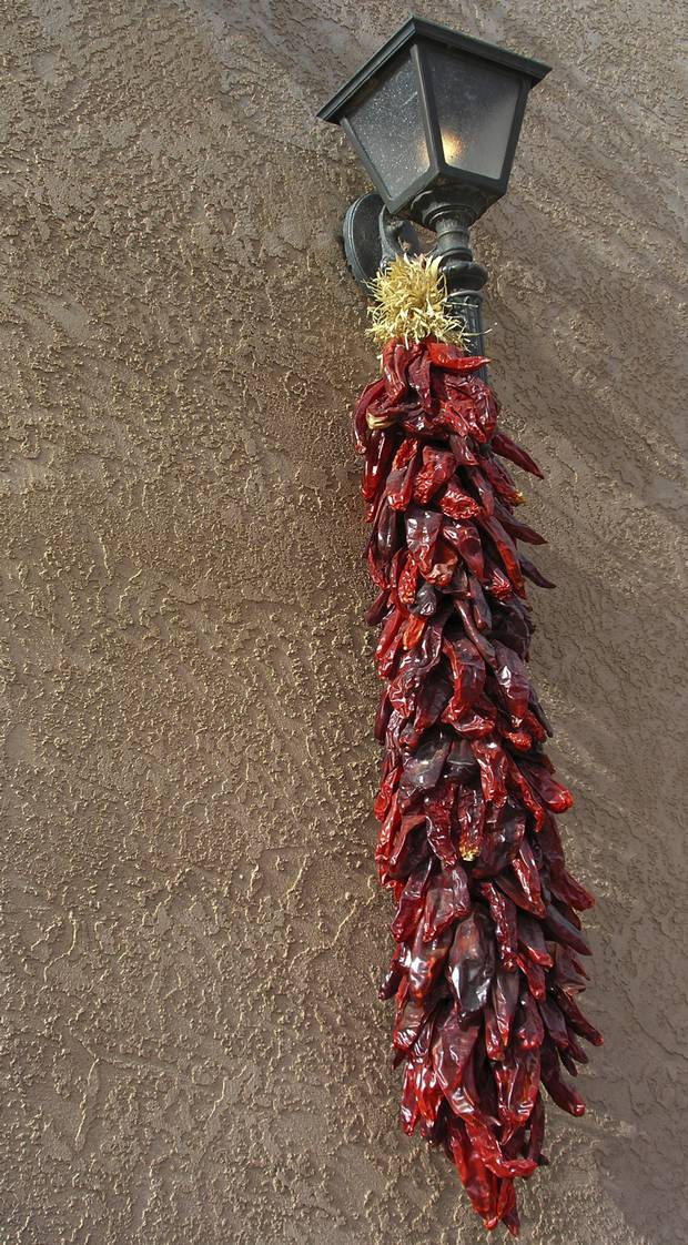 "Many shops around the state display a ""ristra,"" an artfully arranged string of dried chile peppers."