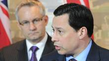 Ontario Minister of Economic Development and Innovation Brad Duguid, right, speaks to reporters following meetings with Minister of International Trade Ed Fast, left, on Feb. 28, 2012. (Sean Kilpatrick/THE CANADIAN PRESS)