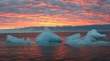 Ice chunks floats in the Arctic Ocean as the sun sets near Barrow, Alaska, Sept. 13, 2006, on the same day two NASA studies reported Arctic sea ice is melting faster which researchers say threatens the ocean's delicate ecosystem. (BETH IPSEN/AP)