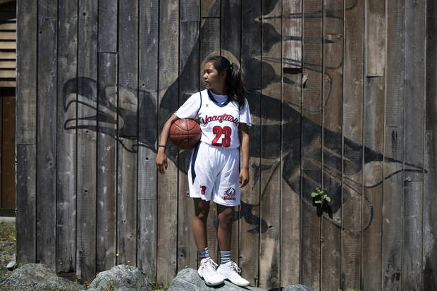Sereana Kaloucokovale, 14, who is a point guard for the Maaqtusiis Thunder, poses for a photo outside of the school in Ahousaht, on Flores Island, in Clayoquot Sound. Melissa Renwick