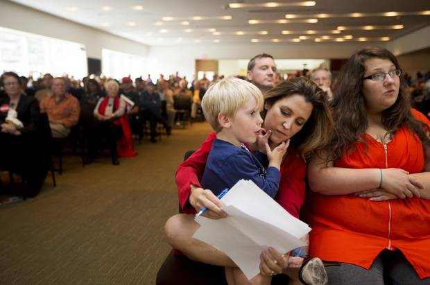 2013: Chrystia Freeland, who is running for the Liberal Party nomination in the by-election to replace Bob Rae as the MP for Toronto Centre, holds her son Ivan Bowley, 4, as she reviews her notes before making a speech ahead of the vote in Toronto on Sunday, September 15, 2013.