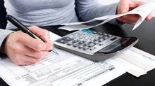 A woman filing her income tax. (Thinkstock)
