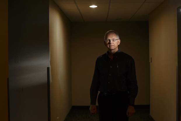 Larry Kelly, seen at the former Venture Publishing offices in Edmonton on Friday, was shocked and devastated when his wife died by suicide in June.