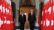 Canada's Prime Minister Stephen Harper walks with China's President Hu Jintao on Parliament Hill in 2010. (JOHN MAJOR/REUTERS)