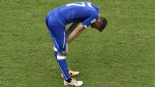 Italy's Ignazio Abate rests briefly during the group D World Cup soccer match between Italy and Costa Rica at the Arena Pernambuco in Recife, Brazil, Friday, June 20, 2014. (Associated Press)
