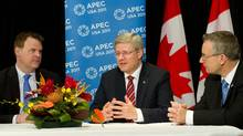Prime Minister Stephen Harper takes part in a briefing with Minister of Foreign Affairs John Baird, left, and Ed Fast, Minister of International Trade, right, during the 2011 APEC Summit in Honolulu, Hawaii on Saturday, November 12, 2011. (Sean Kilpatrick/THE CANADIAN PRESS)