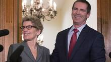 Outgoing Ontario Premier Dalton McGuinty and incoming premier Kathleen Wynne pose for media after a meeting at the Queen's Park in Toronto on Monday, January 28, 2013. (Chris Young/THE CANADIAN PRESS)