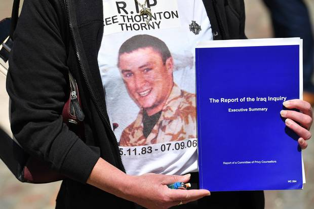 The mother of Gunner Lee Thornton – who died on Sept. 7, 2006, from wounds suffered while fighting in Iraq – holds a summary of the Iraq inquiry report in London on July 6, 2016.