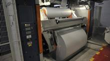 In this file photo, paper on rollers are about to be fed into the presses at a Transcontinental plant. (J.P. Moczulski for The Globe and Mail)